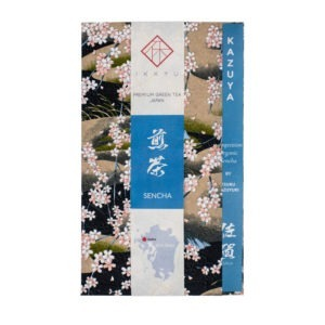 Japanese green tea bag wrapped in traditional Japanese washi paper for an organic competition grade sencha from Saga, Japan, named 'KAZUYA'. The package is made of a washi sheet, a washi obi and inner information sheet.