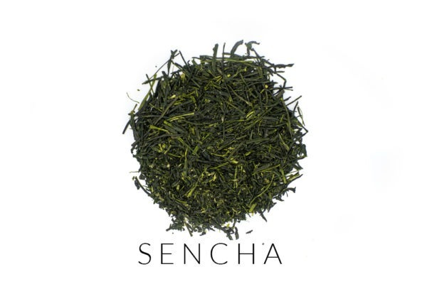 Needle-shaped and deep emerald premium sencha green tea leaves from Yame, Japan, in a circle shape. Under the leaves, the word SENCHA is written.