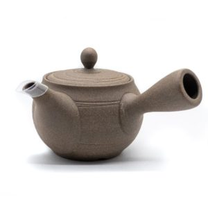 Front of light-brown clay Japanese tea pot (kyusu) made in Tokoname, with a side handle.