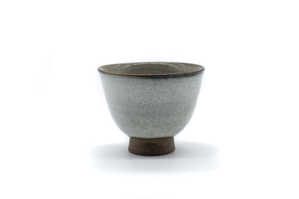 Front side of a small and delicate grey handmade cup for drinking gyokuro green tea, made in Koishiwara, Fukuoka, Japan by Onimaru the Second
