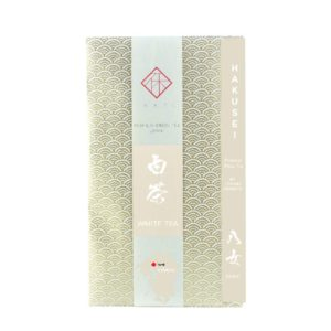 A bag of 50g of HAKUSEI, a premium Japanese white tea from Yame area, Fukuoka, Japan, sold by IKKYU and wrapped in traditional Japanese white-gold washi paper.